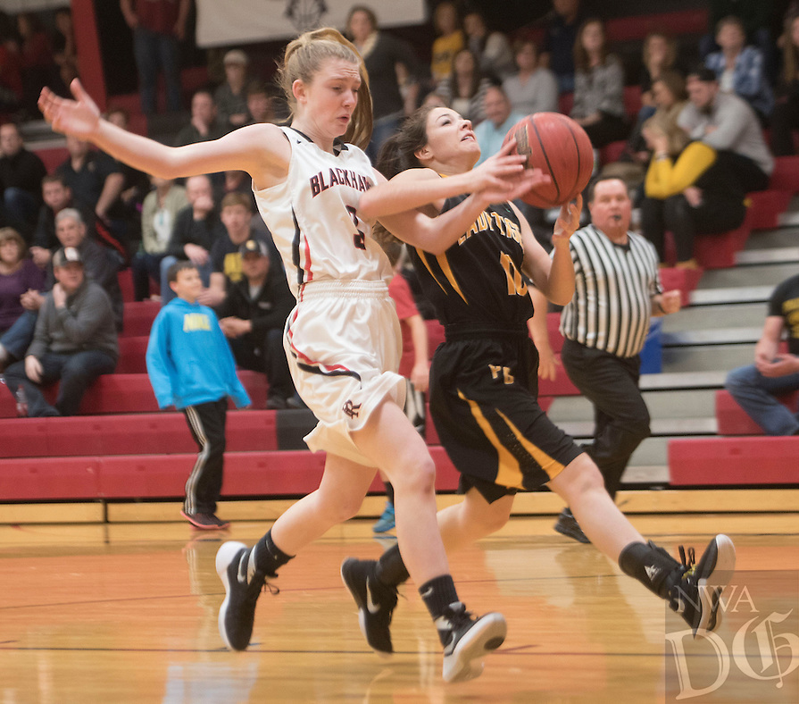 NWA Democrat-Gazette/J.T. WAMPLER Prairie Grove's Taylor Doss draws a foul from Pea Ridge's Kiley West Tuesday Feb. 2, 2016. The Tigers won 57-35. For a gallery of game images go to: http://nwamedia.photoshelter.com/