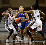 SIOUX FALLS MARCH 22:  Macchi Smith #23 of Bentley passes between Virginia Union defenders Kiana Johnson #3 and Ashley Smith #4 during their quarterfinal game at the NCAA Women's Division II Elite 8 Tournament at the Sanford Pentagon in Sioux Falls, S.D. The ball bounced off the rim as Bentley won 53-52. (Photo by Dick Carlson/Inertia)