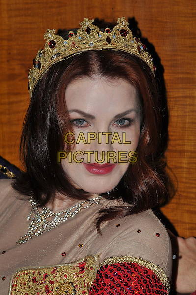 Priscilla Presley.Press launch to star in New Wimbledon Theatre's annual pantomime offering 'Snow White and the Seven Dwarfs' at The Savoy, Strand, London, England..September 26th, 2012.panto costume headshot portrait gold red crown sequins sequined  .CAP/BF.©Bob Fidgeon/Capital Pictures.