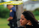 A young woman weeps at a murder scene in Gentilly, 2009
