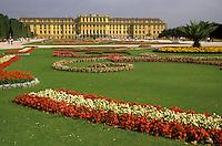 AJ2162, Vienna, Austria, Europe, Beautiful flower gardens decorate the lawn of the Schonbrunn Schloss Palace. A 1, 440-room summer palace.