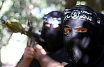 Palestinian militants of the Nasser Salah al-Din Brigades, the military wing of the Popular Resistance Movement take part in a training exercise in Gaza City on Nov 22,2010. The Nasser Salah al-Din Brigades warned Israel from any offensive on Gaza Strip.. Photo by Ashraf Amra