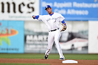 Dunedin Blue Jays shortstop Emilio Guerrero (13) throws to first during a game against the Daytona Cubs on April 14, 2014 at Florida Auto Exchange Stadium in Dunedin, Florida.  Dunedin defeated Daytona 1-0  (Mike Janes/Four Seam Images)