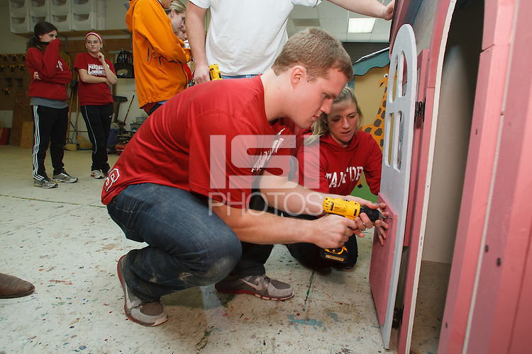MILPITAS, CA -- January 19, 2013: Members of Stanford Athletics teams worked together Saturday, Jan. 19 building play houses for Habitat for Humanity to donate to local families and organizations in need. Athletes Ryan Hewitt and Alex Doll constructed, assembled and decorated the houses and met recipients at the end of the project.