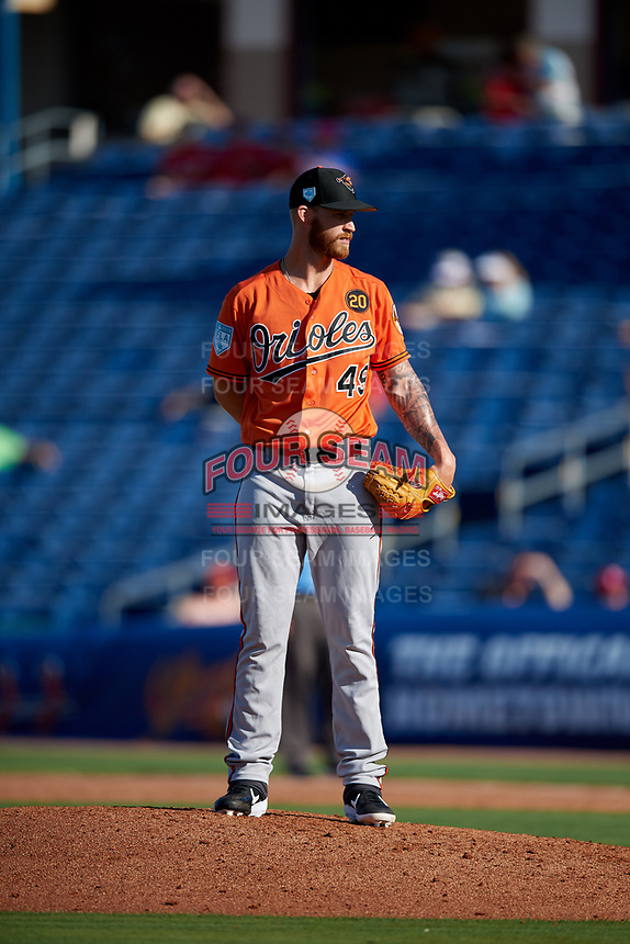 Baltimore Orioles relief pitcher Cody Carroll (49) looks in for the sign during a Grapefruit League Spring Training game against the Philadelphia Phillies on February 28, 2019 at Spectrum Field in Clearwater, Florida.  Orioles tied the Phillies 5-5.  (Mike Janes/Four Seam Images)