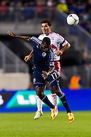 C.J. Sapong (17) of Sporting Kansas City goes up for a header with Rafa Marquez (4) of the New York Red Bulls. The New York Red Bulls and Sporting Kansas City played to a 0-0 tie during a Major League Soccer (MLS) match at Red Bull Arena in Harrison, NJ, on October 20, 2012.
