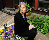 Nancy Jesse, Wisconsin People & Ideas short story winner, sits on her patio in Madison, Wisconsin