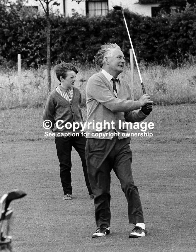 Northern Ireland  golfer, Fred Daly, Belfast, playing an iron shot to a green at Balmoral Golf Club, where he is the professional. July 1969. 196907000197c..Copyright Image from Victor Patterson, 54 Dorchester Park, Belfast, UK, BT9 6RJ..Tel: +44 28 9066 1296.Mob: +44 7802 353836.Voicemail +44 20 8816 7153.Skype: victorpattersonbelfast.Email: victorpatterson@me.com.Email: victorpatterson@ireland.com (back-up)..IMPORTANT: If you wish to use this image or any other of my images please go to www.victorpatterson.com and click on the Terms & Conditions. Then contact me by email or phone with the reference number(s) of the image(s) concerned.