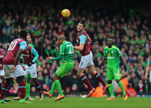 27.02.2016. Boleyn Ground, London, England. Barclays Premier League. West Ham versus Sunderland. West Ham United Striker Andy Carroll heads the ball forward