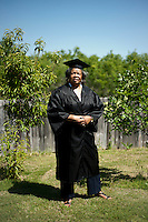 Burlyce Sherrell Logan (cq), a 73-year old woman who is graduating from the University of North Texas, tries on her graduation regalia at home in Denton, Texas, Friday, May 6, 2011. Burlyce first attended the university in 1956, as part of.the group of African-Americans who were integrating it, but the atmosphere was so hostile she dropped out...Photo by Matt Nager