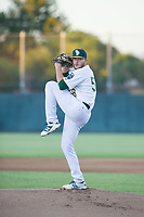 AZL Athletics starting pitcher Osvaldo Berrios (58) delivers a pitch to the plate against the AZL Brewers on August 18, 2017 at Lew Wolff Training Complex in Mesa, Arizona. AZL Brewers defeated the AZL Athletics 6-4. (Zachary Lucy/Four Seam Images)