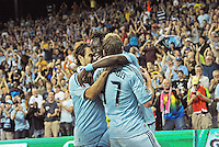 Sporting KC players Graham Zusi, Kei Kamara celebrate Jacob Peterson (37) opening goal..Sporting Kansas City defeated Philadelphia Union 2-1 at LIVESTRONG Sporting Park, Kansas City, KS.
