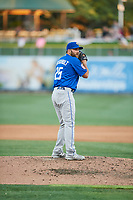 Kyle Regnault (25) of the Las Vegas 51s delivers a pitch to the plate against the Salt Lake Bees at Smith's Ballpark on May 7, 2018 in Salt Lake City, Utah. The 51s defeated the Bees 10-8. (Stephen Smith/Four Seam Images)