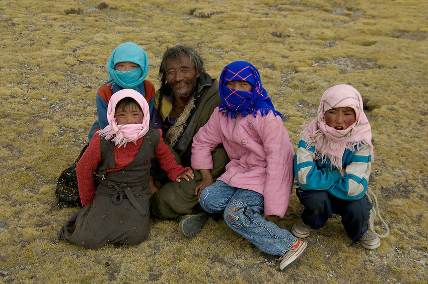 78 year old Tibetan Nomad and his Grand Children near Lake Namtso 78 year old Tibetan Nomad near Lake Namtso at an altitude of 4800 meters.