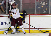 Michael Matheson (BC - 5), Justin Hussar (Merrimack - 18) - The Boston College Eagles defeated the visiting Merrimack College Warriors 4-3 on Friday, November 16, 2012, at Kelley Rink in Conte Forum in Chestnut Hill, Massachusetts.