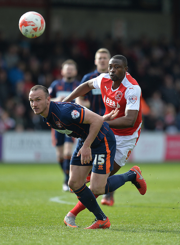 Blackpool's Tom Aldred battles with Fleetwood Town's Shola Ameobi<br /> <br /> Photographer Dave Howarth/CameraSport<br /> <br /> Football - The Football League Sky Bet League One - Fleetwood Town v Blackpool - Saturday 23rd April 2016 - Highbury Stadium - Fleetwood  <br /> <br /> &copy; CameraSport - 43 Linden Ave. Countesthorpe. Leicester. England. LE8 5PG - Tel: +44 (0) 116 277 4147 - admin@camerasport.com - www.camerasport.com