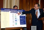 "United States Senator Chuck Schumer (Democrat of New York) points to a chart showing the sources of Al-Qaeda funding at a press conference in the U.S. Capitol in Washington, DC on March 19, 2003.  New US documents identified Saudi Arabian families as among the first financial backers od Al-Qaeda and show that it received funding from Saudi charities.  Schumer urged the end of stonewalling that has kept hidden information on high-ranking Saudis who served as ""funding fathers"" of Al_Qaeda.<br />