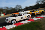 Richard Breland, car 81 chases Derek Brook, car 24 and Iain Cameron at Brands Hatch in the Ma5da Racing MX5 Championship