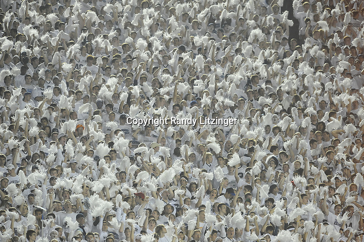27 September 2008:  The Penn State student section shakes their white pom poms as part of the whole stadium white out or white house..The Penn State Nittany Lions defeated the Illinois Fighting Illini 38-24 September 27, 2008 at Beaver Stadium in State College, PA..