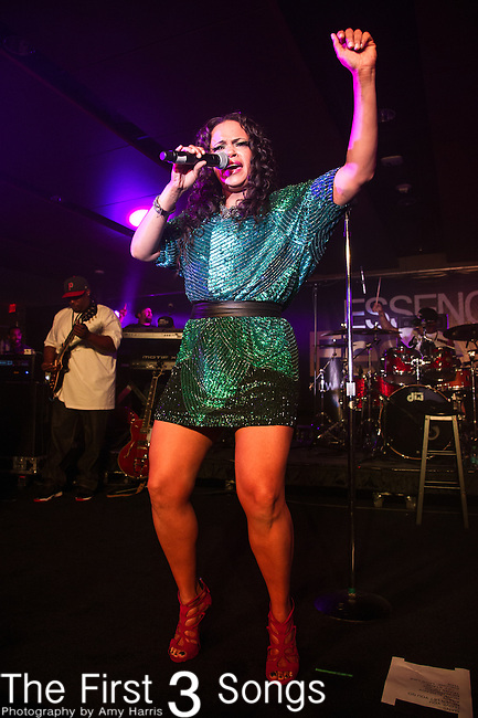 Faith Evans performs at the 2013 Essence Festival at the Mercedes-Benz Superdome in New Orleans, Louisiana.