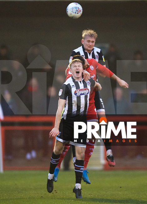 Ludvig Ohman of Grimsby Town wins the header from Ollie Palmer of Crawley Town during the Sky Bet League 2 match between Crawley Town and Grimsby Town at The People's Pension Stadium, Crawley, England on 25 January 2020. Photo by Alan  Stanford / PRiME Media Images.