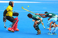 Pakistan forwards duck as a fierce cross fails to trouble India's Vikas Dahiya during the Hockey World League Semi-Final match between Pakistan and India at the Olympic Park, London, England on 18 June 2017. Photo by Steve McCarthy.