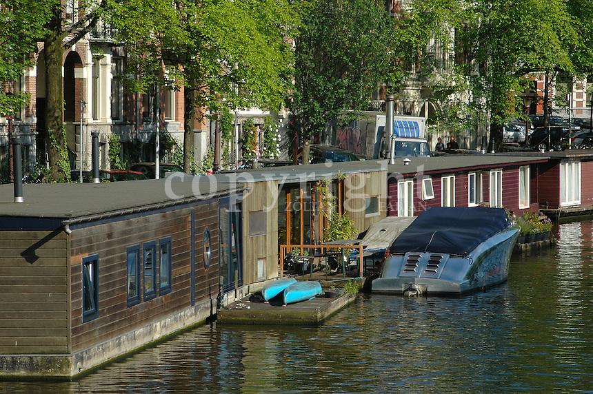Boathouses on the water in Amsterdam