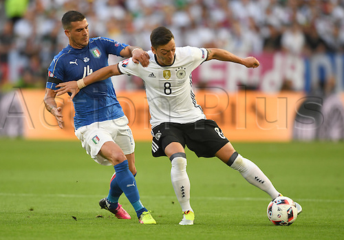 02.07.2016. Bordeaux, France.  Germany's Mesut Oezil (R) holds off Italy's Stefano Sturaro during the UEFA EURO 2016 quarter final  match between Germany and Italy at the Stade de Bordeaux in Bordeaux, France, 02 July 2016.