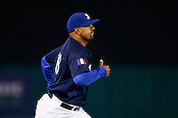21 September 2012: Pitcher Keino Perez runs to the mound from the bullpen during France vs South Africa tie game 2-2, rain delayed at the end of the 9th inning at 1 AM, during the 2012 World Baseball Classic Qualifier round, in Jupiter, Florida, USA. Game to resume 22 September 2012 at noon.