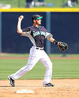 Dustin Ackley #13 of the Seattle Mariners plays second base in a spring training game against the San Diego Padres at Peoria Stadium on February 27, 2011  in Peoria, Arizona. .Photo by:  Bill Mitchell/Four Seam Images.