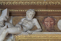 Ephebe in carved stucco and painted laughing satyr head from the frame of the fresco the Disappointed Venus by Rosso Fiorentino, 1535-37, in the Galerie Francois I, begun 1528, the first great gallery in France and the origination of the Renaissance style in France, Chateau de Fontainebleau, France. The Palace of Fontainebleau is one of the largest French royal palaces and was begun in the early 16th century for Francois I. It was listed as a UNESCO World Heritage Site in 1981. Picture by Manuel Cohen