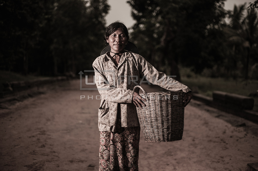 UNESCO World Heritage Site,  Ankgor wat temples and portraits of local  woman who  make her living by selling crafts and other products to tourists.   Seam Reap, Cambodia.