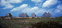 These buildings were used to house the slaves that had to labour to produce salt.  Bonair salt works. Bonair, Netherland Antilles.