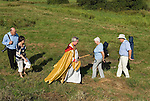 The Bishop of Norwich the Rev Graham James leaves the site at Ludham of the ruined abbey of St Benets. Norfolk UK.