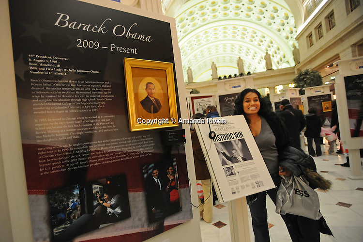"A woman poses for a picture in the ""American Presidents Life Portraits"" exhibit in the main hall of Union Station as hundreds gather in the hopes of catching a glimpse of the 44th U.S. President Barack Obama as his train pulled in after a day-long whistle stop tour of the northeast ahead of Tuesday's inauguration festivities in Washington DC on January 17, 2008."