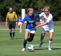 Kaitlyn Kerr (5) of Duke tries to make her way past Julia Roberts (8) of Virginia during the game at Klockner Stadium in Charlottesville, VA.  Virginia defeated Duke, 1-0.