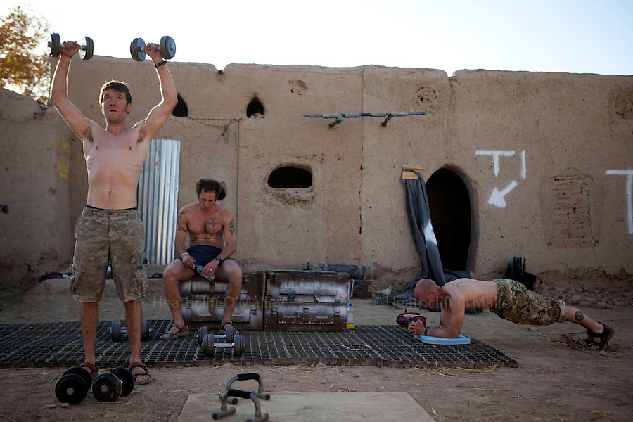 Mcc0027461 . Daily Telegraph..Pte Luke Flanagan, LCpl Ben Pilgrim and LCpl Glen McAllister work-out at the base gym...Photos showing life for the men at CP Qudrat from A Coy, 3 Para in the northern Nad e Ali district of Helmand Province...Helmand 6 December 2010