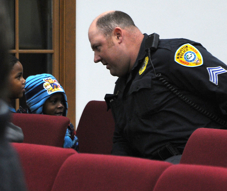 One of the Police Officers in the audience at a Community Policing Forum, sponsored by the Kingston Branch of ENJAN and the Ministers Alliance of Ulster Co., held at New Progressive Baptist Church, on Hone Street in Kingston, NY, on Tuesday, December 13, 2016. Photo by Jim Peppler; Copyright Jim Peppler 2016.
