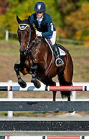 Harbour Pilot, with rider Hannah Sue Burnett, competes during the Stadium Jumping test during the Fair Hill International at Fair Hill Natural Resources Area in Fair Hill, Maryland on October 21, 2012. Burnett won her third Fair Hill International with a double clear stadium jumping round.