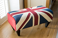 In the living room an amusing footstool with a Union Jack motif is tucked in a corner in front of one of the louvred windows