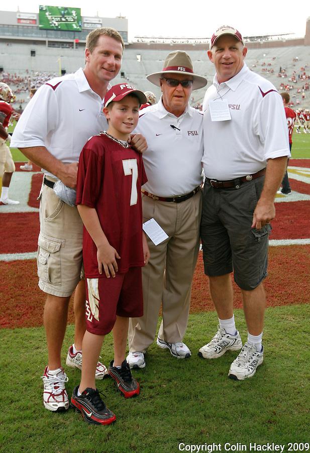 TALLAHASSEE, FL 10/31/09-FSU-NCST FB09 CH01-Florida State Head Coach Bobby Bowden poses with Casey Weldon, left, and son and the father of Caz Piurowski, prior to the Home Coming game against N.C. State, Saturday at Doak Campbell Stadium in Tallahassee. .COLIN HACKLEY PHOTO