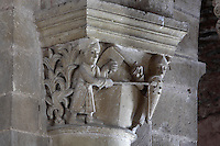 Carved capital of a battle between 2 knights, with a lance piercing a shiled, in the galleries of the Abbatiale Sainte-Foy de Conques or Abbey-church of Saint-Foy, Conques, Aveyron, Midi-Pyrenees, France, a Romanesque abbey church begun 1050 under abbot Odolric to house the remains of St Foy, a 4th century female martyr. The pattern of nails on the shield represents the spirit above the 4 elements. The church is on the pilgrimage route to Santiago da Compostela, and is listed as a historic monument and a UNESCO World Heritage Site. Picture by Manuel Cohen