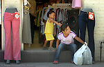 MATAMOROS,MEXICO,5/19/06--FOR METRO STORY SLUGGED: BORDER--Susanna Tovar, 8, watches one of her siblings as he mother shops in a store in Matamoros Mexico. Some seasonal workers from the Tampa area call Matamoros home. (staff/Jay Nolan)