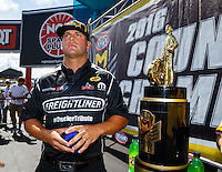 Sep 18, 2016; Concord, NC, USA; NHRA funny car driver Matt Hagan alongside the championship trophy during the Carolina Nationals at zMax Dragway. Mandatory Credit: Mark J. Rebilas-USA TODAY Sports