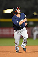 Gwinnett Braves shortstop Sean Kazmar (9) watches the ball as he runs the bases during a game against the Buffalo Bisons on May 13, 2014 at Coca-Cola Field in Buffalo, New  York.  Gwinnett defeated Buffalo 3-2.  (Mike Janes/Four Seam Images)