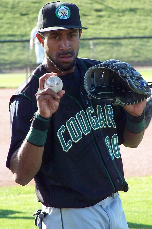 APPLETON - JUNE 2009: Christian Berroa of the Kane County Cougars, Class-A affiliate of the Oakland A's, warms up prior to a game on June 13, 2009 at Fox Cities Stadium in Appleton, Wisconsin. (Photo by Brad Krause)