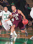 Louisiana Monroe Warhawks guard Charles Winborne (11) in action during the game between the Louisiana Monroe Warhawks and the University of North Texas Mean Green at the North Texas Coliseum,the Super Pit, in Denton, Texas. UNT defeats ULM 86 to 51...