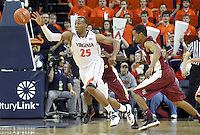 Virginia forward Akil Mitchell (25) steals the ball in front of Florida State guard Devon Bookert (1) and Florida State forward Okaro White (10) during the second half of an NCAA basketball game Saturday Jan. 18, 2014 in Charlottesville, VA. Virginia defeated Florida State 78-66. (AP Photo/Andrew Shurtleff)