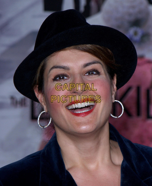 NIA VARDALOS.Los Angeles Premiere of The LadyKillers held at The El Capitan Theatre in Hollywood, California .12 March 2004.*UK Sales Only*.portrait, headshot, red lipstick, make-up, hoop earrings, trilby hat.www.capitalpictures.com.sales@capitalpictures.com.©Capital Pictures.