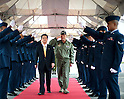 April 23, 2011, Yokota Air Base, Japan - Toshimi Kitazawa and Lt. Gen. Burton Field walk through an honor guard cordon April 23, 2011, at Yokota Air Base, Japan. Minister Kitazawa visited Yokota AB to thank U.S. service members for their efforts in support of Operation Tomodachi and to observe a bilateral demonstration of the U.S. Marine's and Japan Ground Self-Defense Force chemical response forces. Mr. Kitazawa is the Japan Minister of Defense and General Field is the U.S. Forces Japan and 5th Air Force commander. (U.S. Air Force photo/Staff Sgt. Chad C. Strohmeyer)